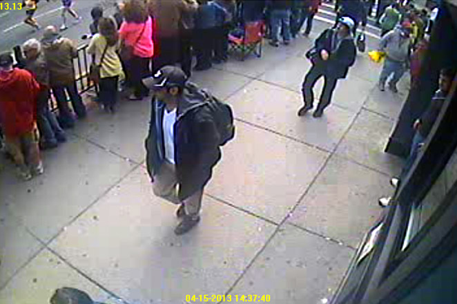 This FBI image shows two suspects of the Boston bombings walking near the marathon's finish line.