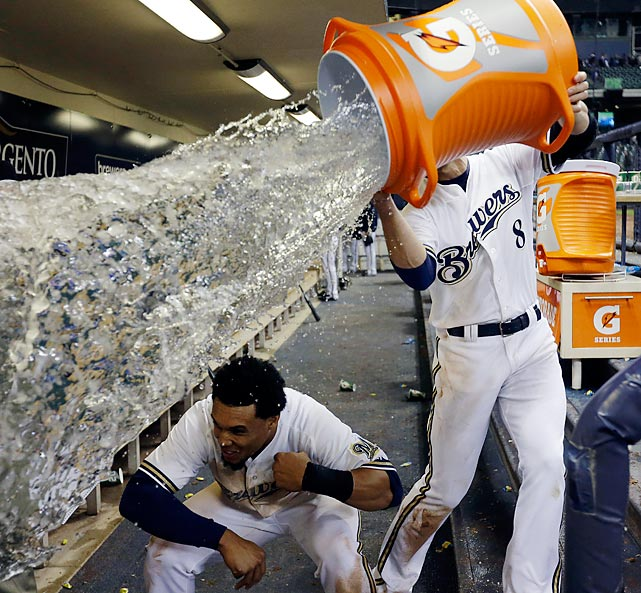 """The two jolly Brewers pull the old """"You-duck-and-I'll-soak-the-media-buzzards"""" trick after their 4-3 win over the San Francisco Giants in Milwaukee."""