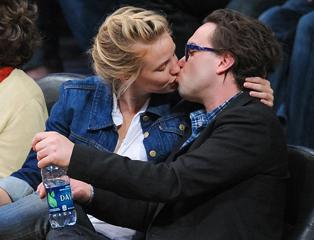 "Prior to their Staples Center smooch, this report in the UK's inimitable <italics>Daily Mail</italics>: ""Maybe the pair are stocking up for a long snuggle session by the fireplace. While Los Angeles enjoys a heat spell, Johnny Galecki and girlfriend Kelli Garner were spotted buying a huge amount of firewood and a few other necessities at a grocery store in Hollywood. The couple, who have been publicly dating for nearly a year, also left the high-end market Bristol Farms with a fresh bouquet of flowers and toilet paper, perhaps suggesting a romantic weekend ahead."" Indeed."