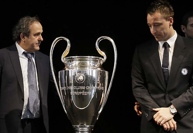 John Terry (right) attends the handing back ceremony of the Champions League trophy with Michel Platini.