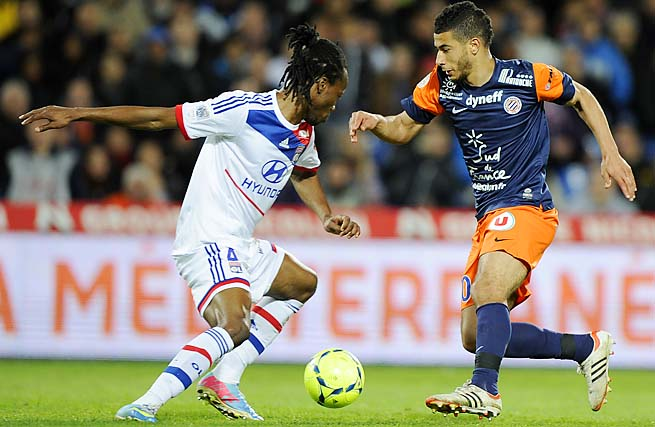 Montpellier's Younes Belhanda (right) vies for the ball with Lyon's Bakary Kone.