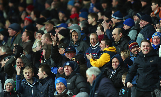 Portsmouth fans celebrate a goal against Coventry City. A supporter's trust now controls the club.