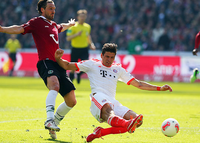 Mario Gomez (right) scored Bayern's third goal against Hannover with this strike at the AWD Arena.