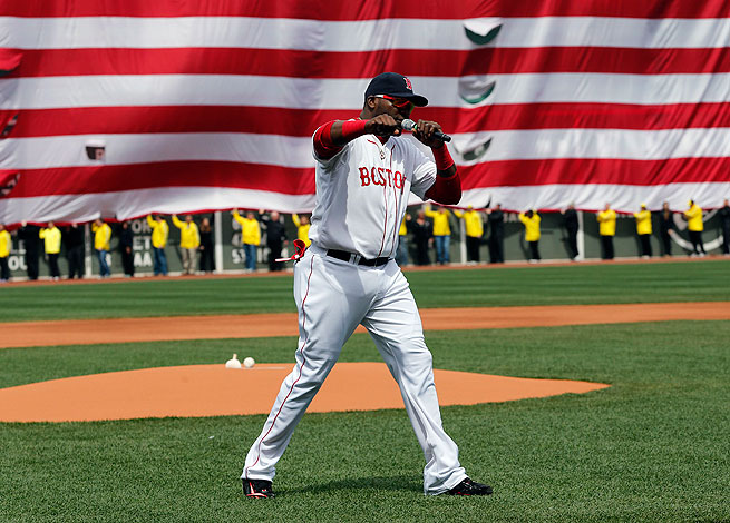 David Ortiz provided the perfect exclamation point to what had been a somber ceremony at Fenway.