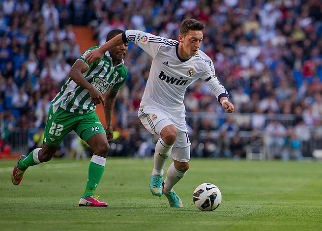 Mesut Ozil (front) scored the opener for Real Madrid before adding another late against Real Betis.