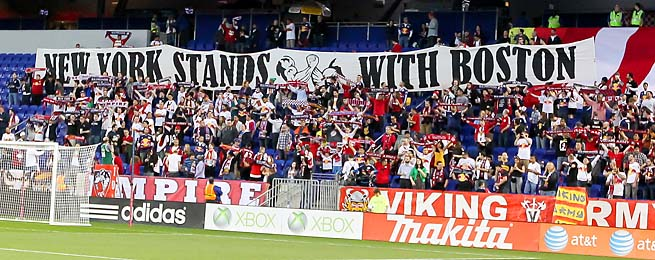 New York Red Bulls fans hold a banner that states in support of Boston before Wednesday's match.