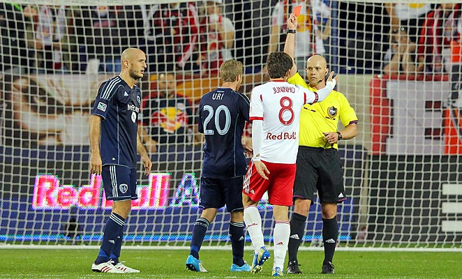 Juninho got a red card for kicking a ball at Kansas City goalkeeper Jimmy Nielsen during a break in play.