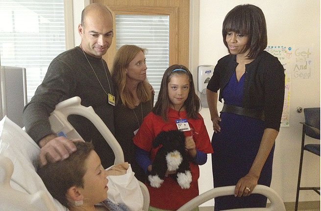 First Lady Michelle Obama also visited 11-year-old Aaron Hern, injured in the Boston Marathon bombing.