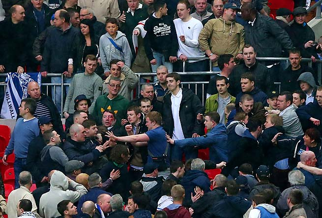 Trouble breaks out between Millwall supporters during the FA Cup semifinal with Wigan on April 13.