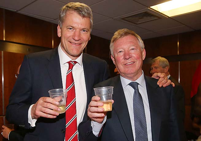 David GIll and Sir Alex Ferguson celebrate Manchester United's Premier League title Monday.