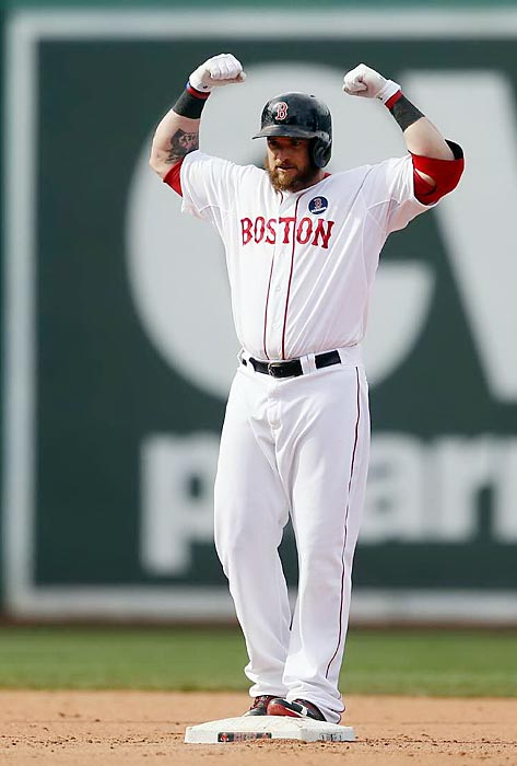 Jonny Gomes flexes some muscle in the Red Sox's Saturday game against the Kansas City Royals. Gomes would notch a run for his team in a 4-3 win.