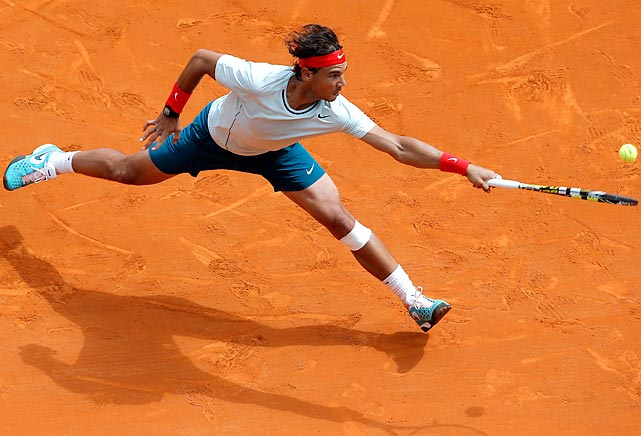 Rafael Nadal stretches for a return against Jo-Wilfried Tsonga during their semifinal match at the Monte Carlo Masters on Saturday. The Spaniard tallied his 46th consecutive win in the tournament to reach the final.