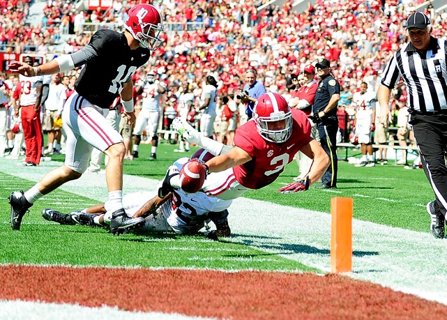 Vinnie Sunseri dives into the end zone to score for the Crimson Team after picking off an interception during Alabama's spring game at Bryant-Denny Stadium on Saturday. Nick Saban glares at the QB (not shown).
