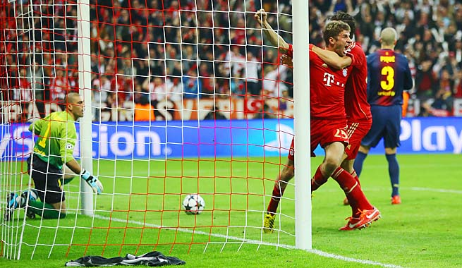 Thomas Mueller celebrates his opening goal for Bayern Munich in the 25th minute.