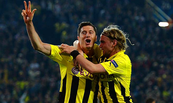Robert Lewandowski (left) celebrates his third of four goals for Dortmund in the 55th minute.