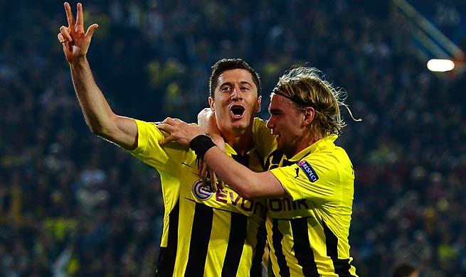 Robert Lewandowski (left) celebrates his third of four goals for Dortmund in the 55th minute.