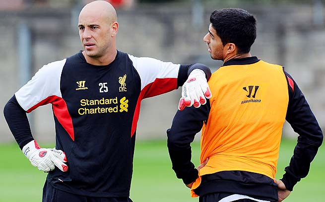 Pepe Reina (left), Luis Suarez (right) and Liverpool are in seventh place in the Premier League.