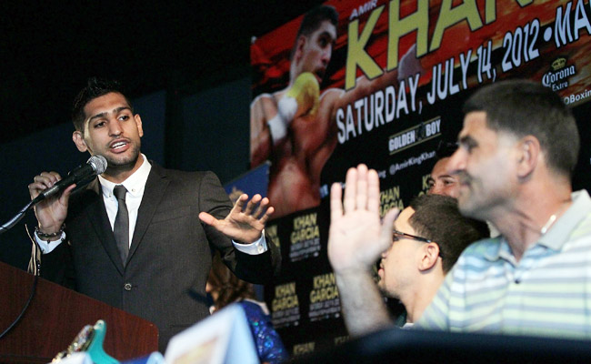 Danny Garcia's father, Angel (right), got under the skin of Amir Khan in July 2012; Khan lost via TKO.