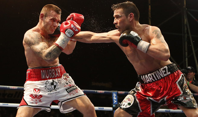Despite rain and Martin Murray's fists, Sergio Martinez held on to his WBC middleweight title.