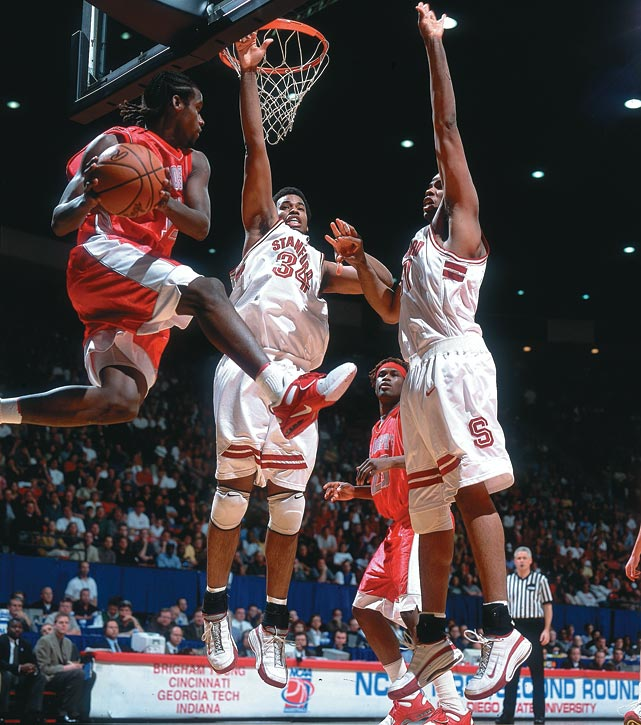 St. Joseph's Marvin O'Connor (11) faces the twin wall of Stanford's Jason (34) and Jarron (31) Collins during the second round of the 2001 NCAA Tournament. The Collins twins were both selected in the 2001 NBA Draft.