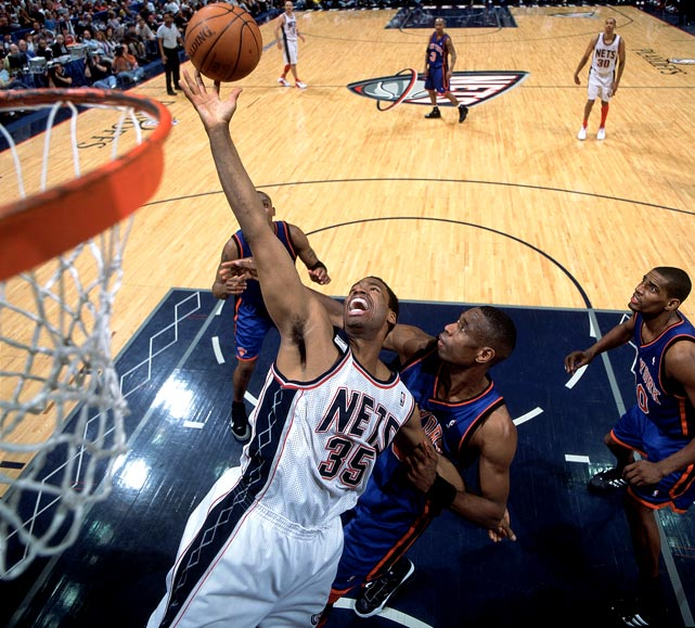 The Nets' Jason Collins battles for a rebound against the New York Knicks in a 2004 playoff game.