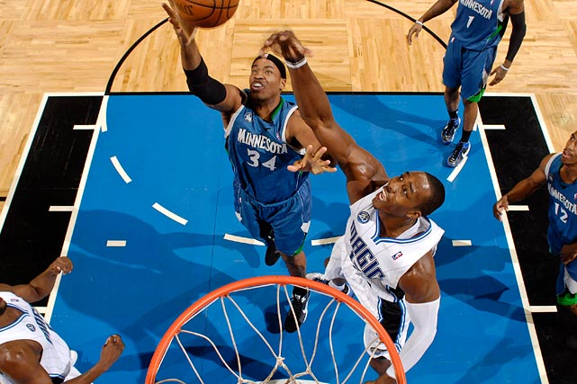 Jason Collins, seen here with the Minnesota Timberwolves, shoots against the Magic's Dwight Howard during a 2008 game.