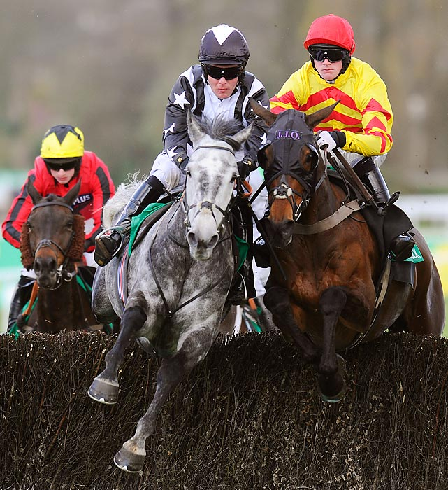 Andrew Tinkler riding Quentin Collonges (middle) battles for supremacy with Same Difference (right) on the way to winning The bet365 Gold Cup Steeplechase in Esher, England on April 27.