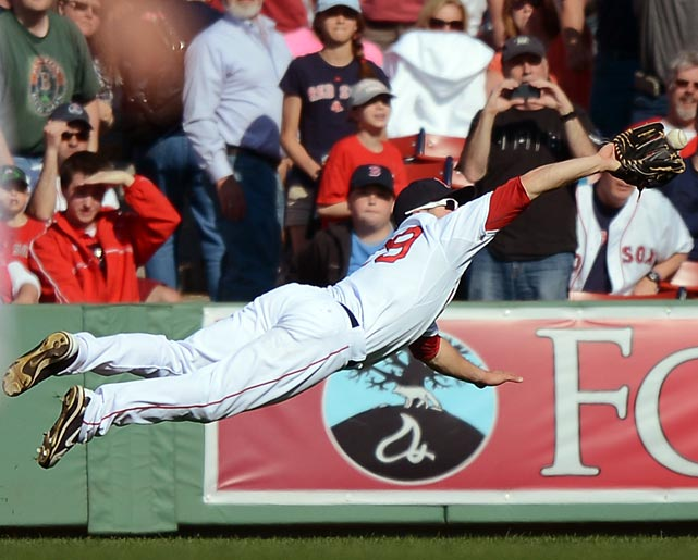 Daniel Nava of the Boston Red Sox makes a diving catch late in his team's 6-1 win against the Houston Astros on April 28.