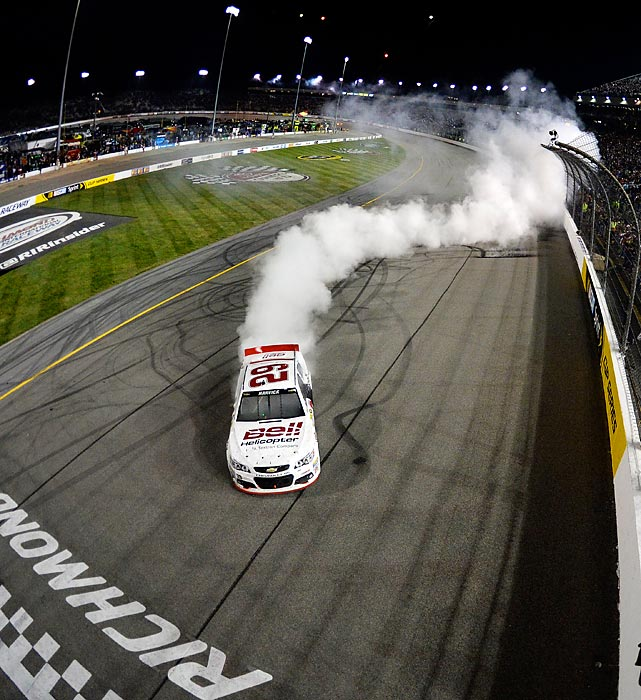 Kevin Harvick enjoys a weaving celebratory burnout after wining the NASCAR Sprint Cup Series Toyota Owners 400 in Richmond on April 27.