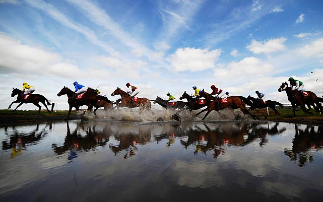 "Riders charge through ""Joe's Water Splash' at Punchtown racecourse in Naas, Ireland on April 23."