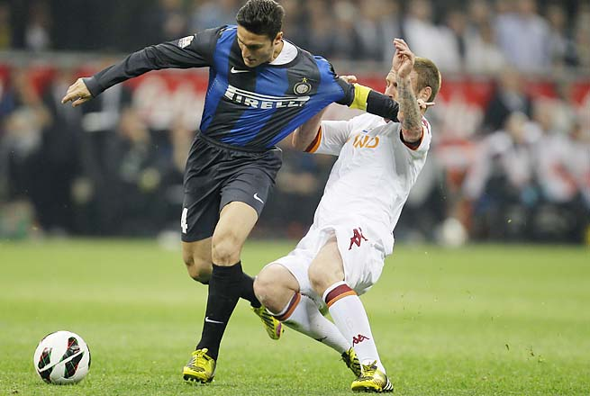 Javier Zanetti vies for the ball with AS Roma midfielder Daniele De Rossi in an Italian Cup match.
