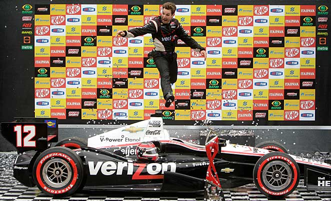 Will Power bounded from his car after winning the Sao Paulo 300 last year.