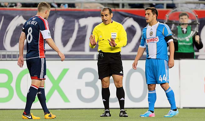 Chris Tierney is cautioned by referee Baldomero Toledo on Saturday against Philadelphia.