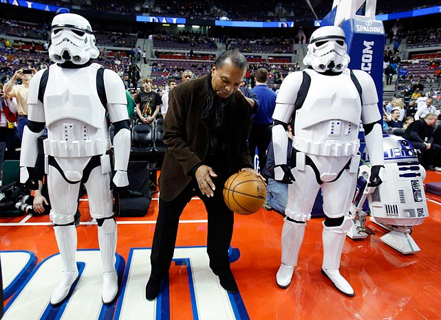 "Billy Dee Williams is flanked by Stormtroopers and R2-D2 while dribbling a basketball before the Detroit Pistons game against the Atlanta Hawks on ""Star Wars Night"" at the Palace of Auburn Hills, Mich., on Jan. 4, 2013."