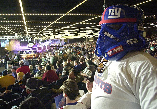 A New York Giants fan looks out at the other fans with his stormtrooper mask during the NFL Draft at Madison Square Garden in New York on April 21, 2001.