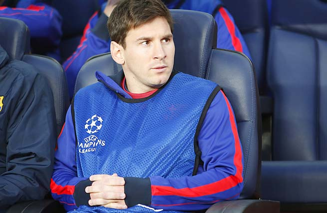 Lionel Messi sits on the bench at the Champions League semifinal return leg on Wednesday.