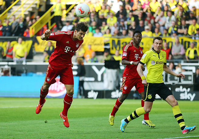 Bayern Munich's Mario Gomez (left) netted a draw for his club with this headed goal in the 23rd minute.