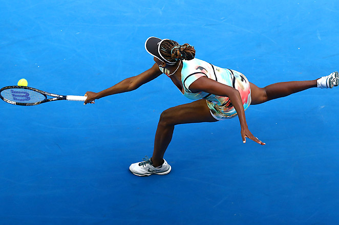 A back injury kept No. 21 Venus off the court, but her sister Serena moved on to the 2nd round in Madrid.