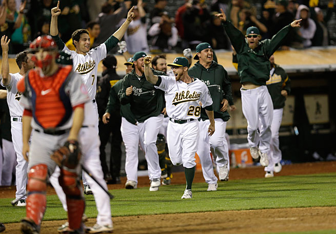 The Angels were dejected and the A's were delighted after Brandon Moss' home run ended their 19-inning game last week.