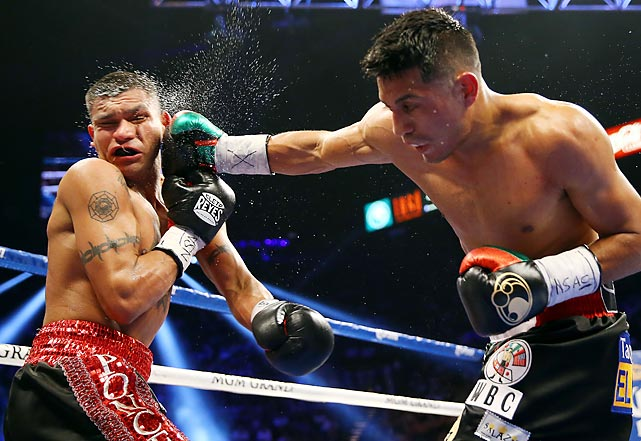 Abner Mares delivers a fierce right to the face of Daniel Ponce de Leon, winning their WBC featherweight title bout at the MGM Grand Garden Arena on May 4 by technical knockout.