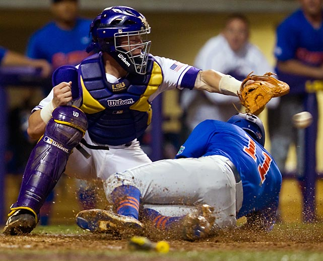 Florida Gators infielder Josh Tobias beats the ball home to score a game-tying run in the 6th inning of a game at the LSU Tigers on May 2, but a winning run from LSU in the 7th would sink the Gators 3-2.
