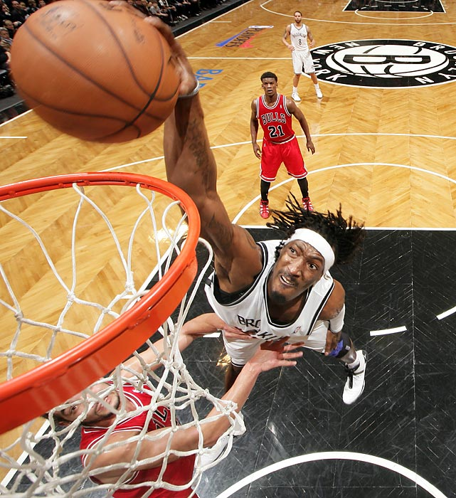 Joakim Noah of the Bulls is helpless to stop this dunk from the Nets' Gerard Wallace, but Wallace was helpless to get his team past Game 7 as Brooklyn fell in the final game of their conference quarterfinal series.