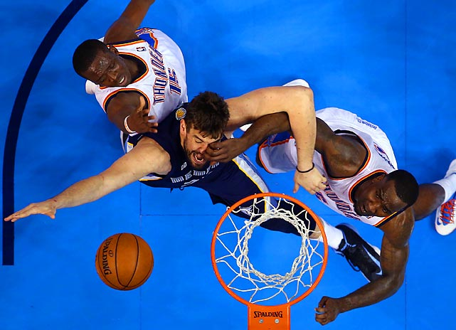 Marc Gasol of the Memphis Grizzlies drives to the basket against Reggie Jackson (left) and Kendrick Perkins of the Oklahoma City Thunder during OKC's 93-91 Game 1 victory to kick off the Western Conference semifinals on May 5.