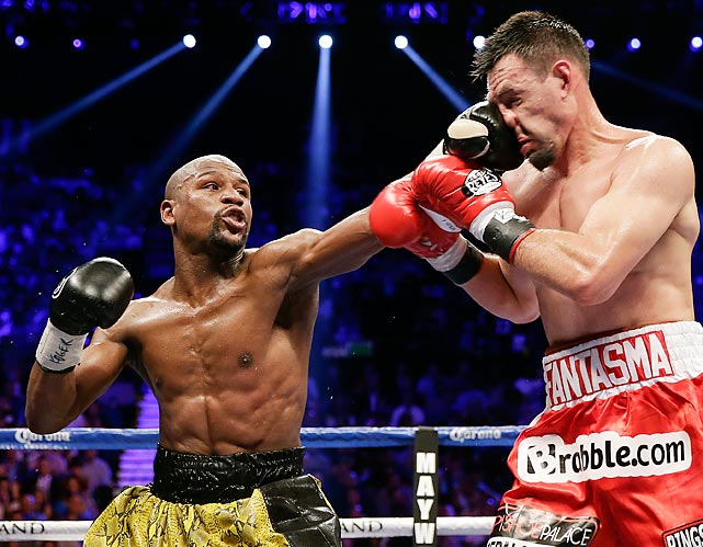Floyd Mayweather Jr. lands a left jab on Robert Guerrero in the fourth round of their WBC welterweight title fight on May 4.