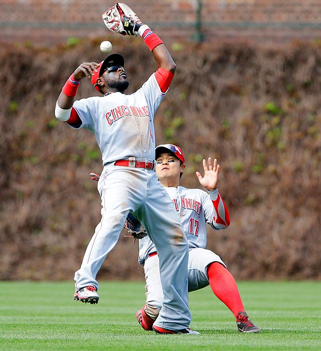 Two Reds couldn't do the job as second baseman Brandon Phillips (left) and center fielder Shin-Soo Choo both fail to make a catch on a two-run double hit by the Chicago Cubs' Alfonso Soriano in the fifth inning of Cincinnati's 7-4 win on May 5.