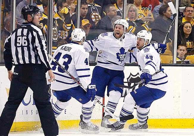 Phil Kessel (center) returned to Boston amid scowls, but finally had a reason to smile in Game 2.