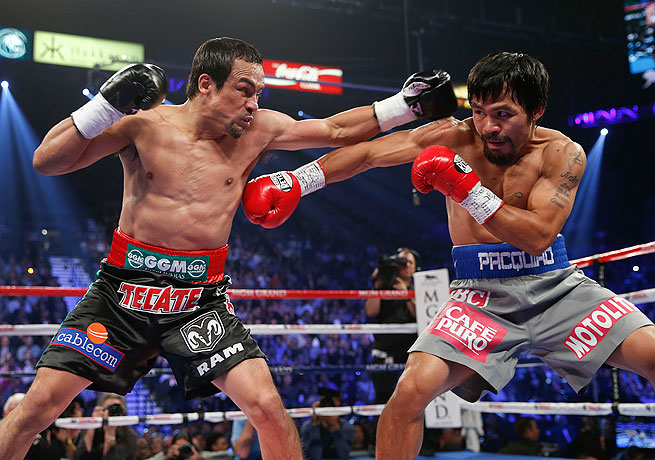 The last time Manny Pacquiao (right) stepped in the ring he was knocked out by Juan Manuel Marquez.