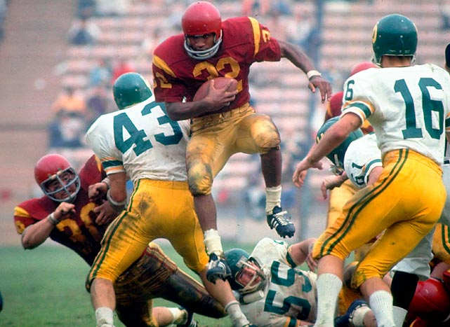 Watch Simpson's famous 64-yard game-winning touchdown run against UCLA in 1967. He dives straight up the middle, dodges arm tackles and shoves a teammate at one point. He bursts to the far sideline and cuts back right, finding a seam and accelerating by defenders. Runs like this are why Simpson is one of the best of all-time. He led the nation in rushing both seasons he played for USC and won the Heisman in 1968.