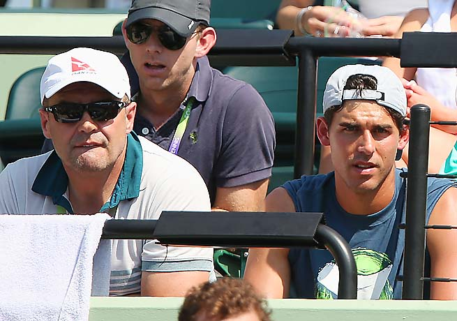 John Tomic (left) has been accused of head-butting and spitting on Thomas Drouet.