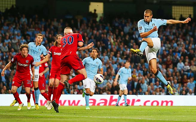 Manchester City's Jack Rodwell takes a shot against West Bromwich Albion on Tuesday.